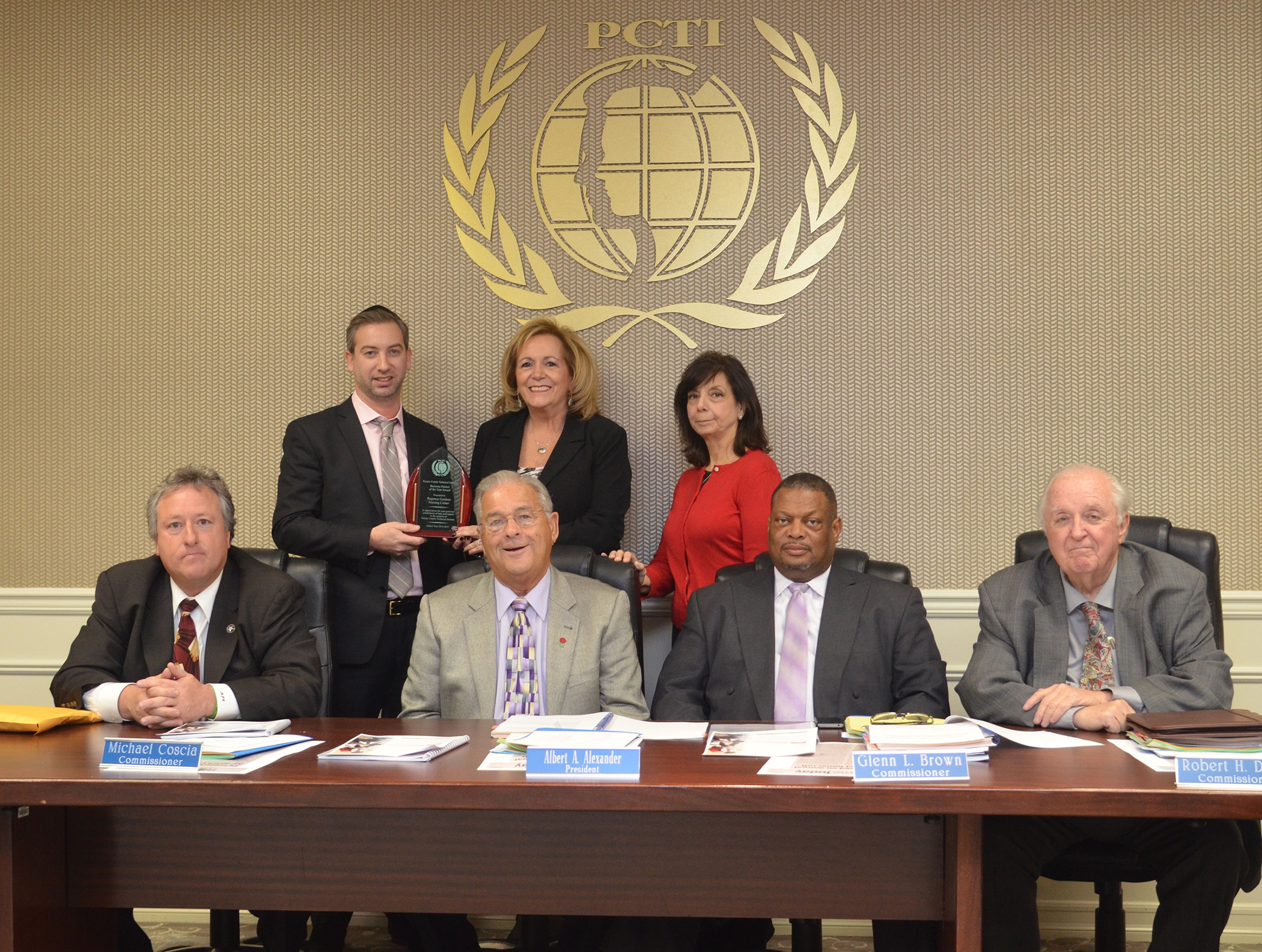 Seated: PCTIC Commissioners And President. Standing Left To Right: Mark  Benedek, Regency